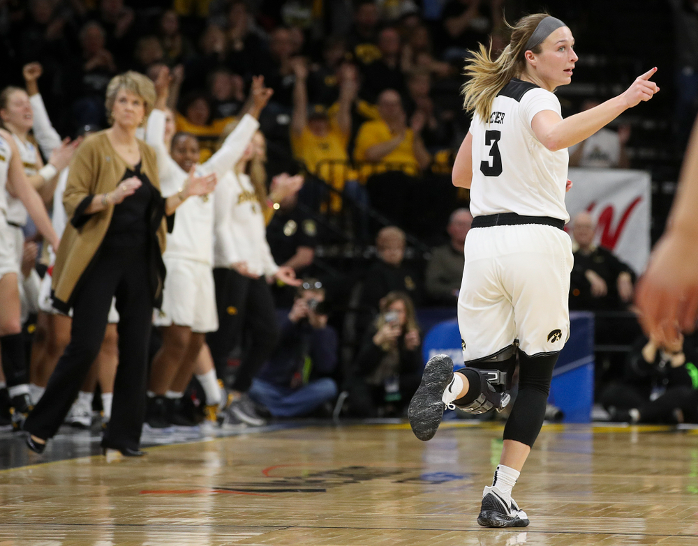 Iowa Hawkeyes guard Makenzie Meyer (3) points at a teammate after making a 3-pointer during the first round of the 2019 NCAA Women's Basketball Tournament at Carver Hawkeye Arena in Iowa City on Friday, Mar. 22, 2019. (Stephen Mally for hawkeyesports.com)