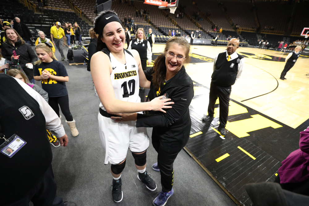 Iowa Hawkeyes forward Megan Gustafson (10) hugs her mother following their game against the Illinois Fighting Illini Thursday, February 14, 2019 at Carver-Hawkeye Arena. (Brian Ray/hawkeyesports.com)