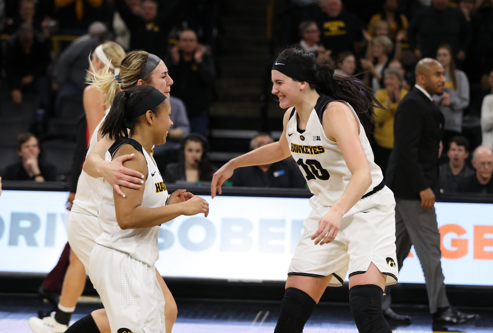 Iowa Hawkeyes forward Megan Gustafson (10), forward Hannah Stewart (21), and guard Tania Davis (11) against the Nebraska Cornhuskers Thursday, January 3, 2019 at Carver-Hawkeye Arena. (Brian Ray/hawkeyesports.com)