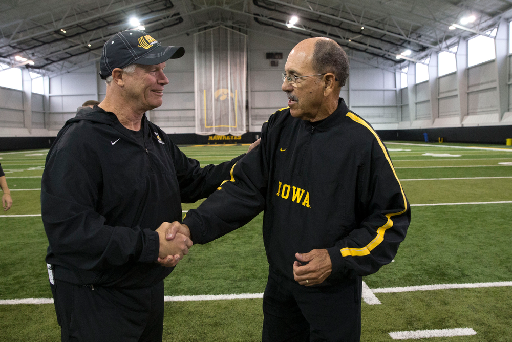 Iowa Hawkeyes defensive line coach Reese Morgan talks with former running backs coach Carl Jackson following their walk through Friday, Oct. 10, 2014 on the indoor field of the Hayden Fry Football Campus.  (Brian Ray/hawkeyesports.com)