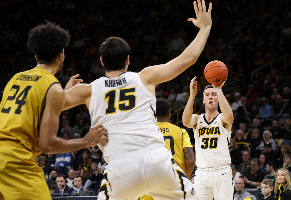 Iowa Hawkeyes guard Connor McCaffery (30) passes the ball during a game against Alabama State at Carver-Hawkeye Arena on November 21, 2018. (Tork Mason/hawkeyesports.com)