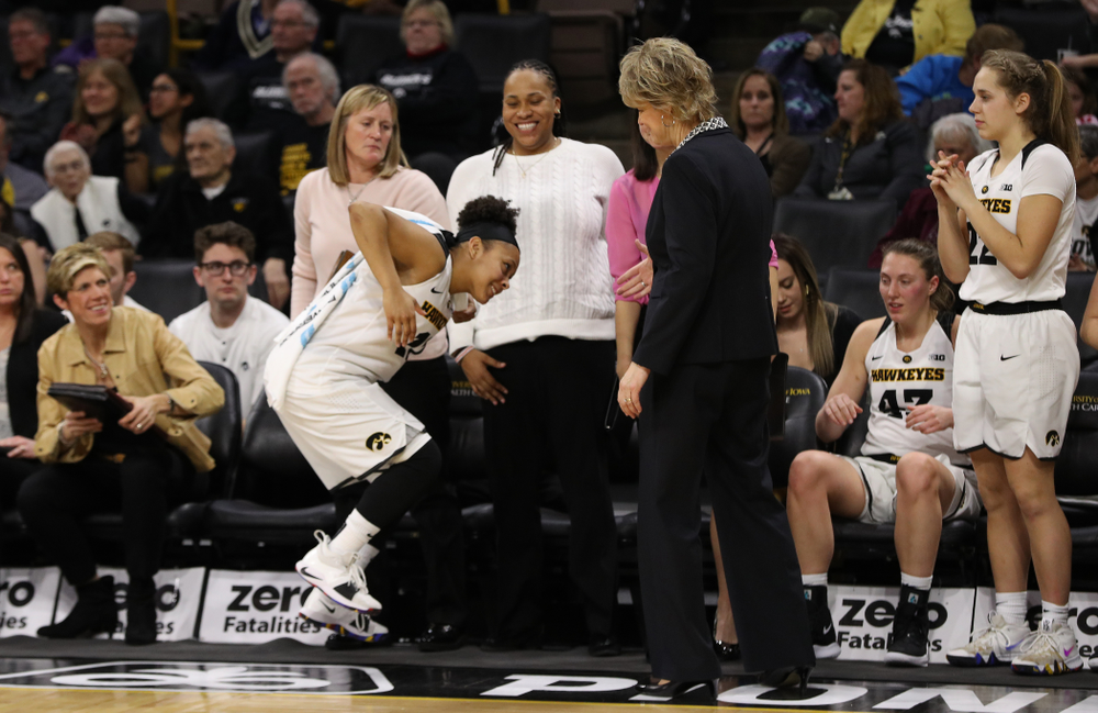 Iowa Hawkeyes guard Tania Davis (11) and head coach Lisa Bluder against the Illinois Fighting Illini Thursday, February 14, 2019 at Carver-Hawkeye Arena. (Brian Ray/hawkeyesports.com)