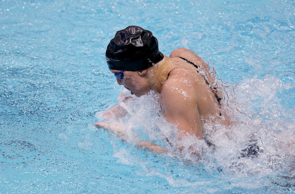 IowaÕs Sage Ohlensehlen swims the breaststroke leg of the 200 Medley Relay against Notre Dame and Illinois Saturday, January 11, 2020 at the Campus Recreation and Wellness Center.  (Brian Ray/hawkeyesports.com)