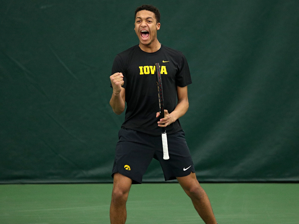 Iowa's Oliver Okonkwo celebrates a point during his doubles match at the Hawkeye Tennis and Recreation Complex in Iowa City on Friday, March 6, 2020. (Stephen Mally/hawkeyesports.com)