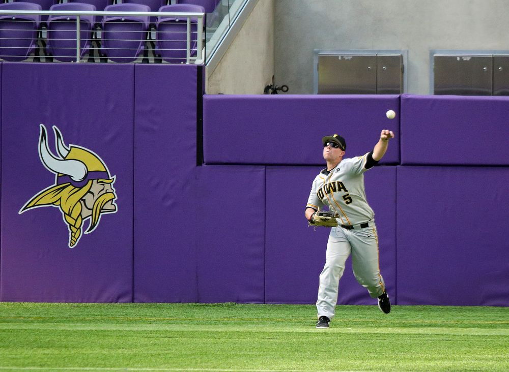 Iowa Hawkeyes outfielder Zeb Adreon (5) throws the ball back to the infield during the eighth inning of their CambriaCollegeClassic game at U.S. Bank Stadium in Minneapolis, Minn. on Friday, February 28, 2020. (Stephen Mally/hawkeyesports.com)