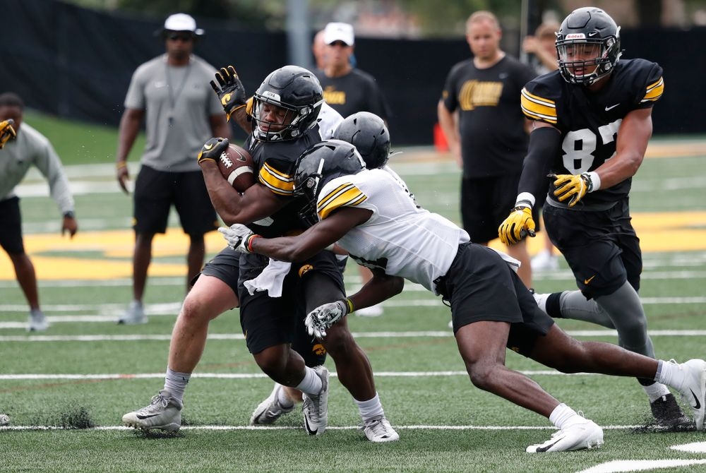 Iowa Hawkeyes running back Mekhi Sargent (10) and defensive back Michael Ojemudia (11) during practice No. 4 of Fall Camp Monday, August 6, 2018 at the Hansen Football Performance Center. (Brian Ray/hawkeyesports.com)