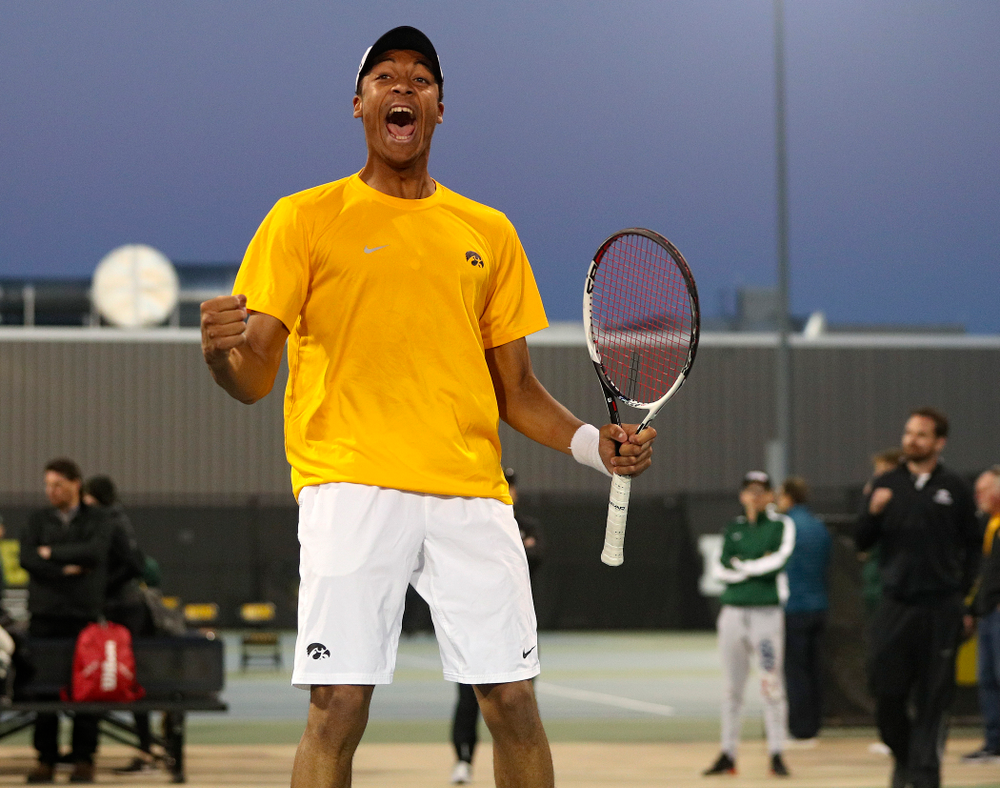 Iowa's Oliver Okonkwo celebrates after winning his match again Michigan State at the Hawkeye Tennis and Recreation Complex in Iowa City on Friday, Apr. 19, 2019. (Stephen Mally/hawkeyesports.com)