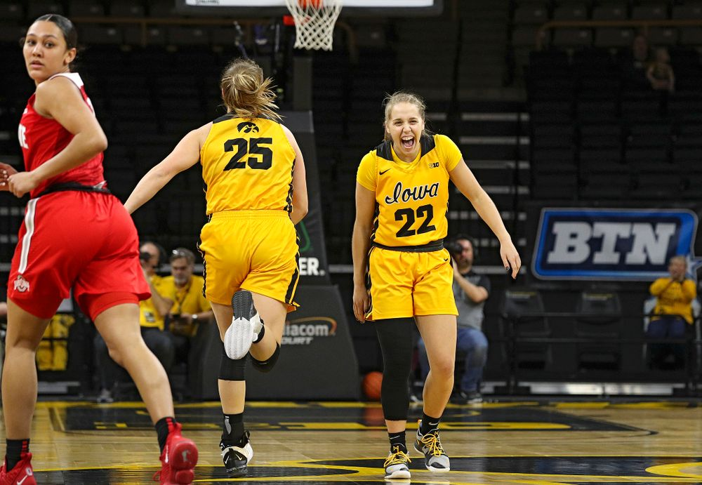 Iowa Hawkeyes guard Kathleen Doyle (22) shares a laugh with forward Monika Czinano (25) during the first quarter of their game at Carver-Hawkeye Arena in Iowa City on Thursday, January 23, 2020. (Stephen Mally/hawkeyesports.com)