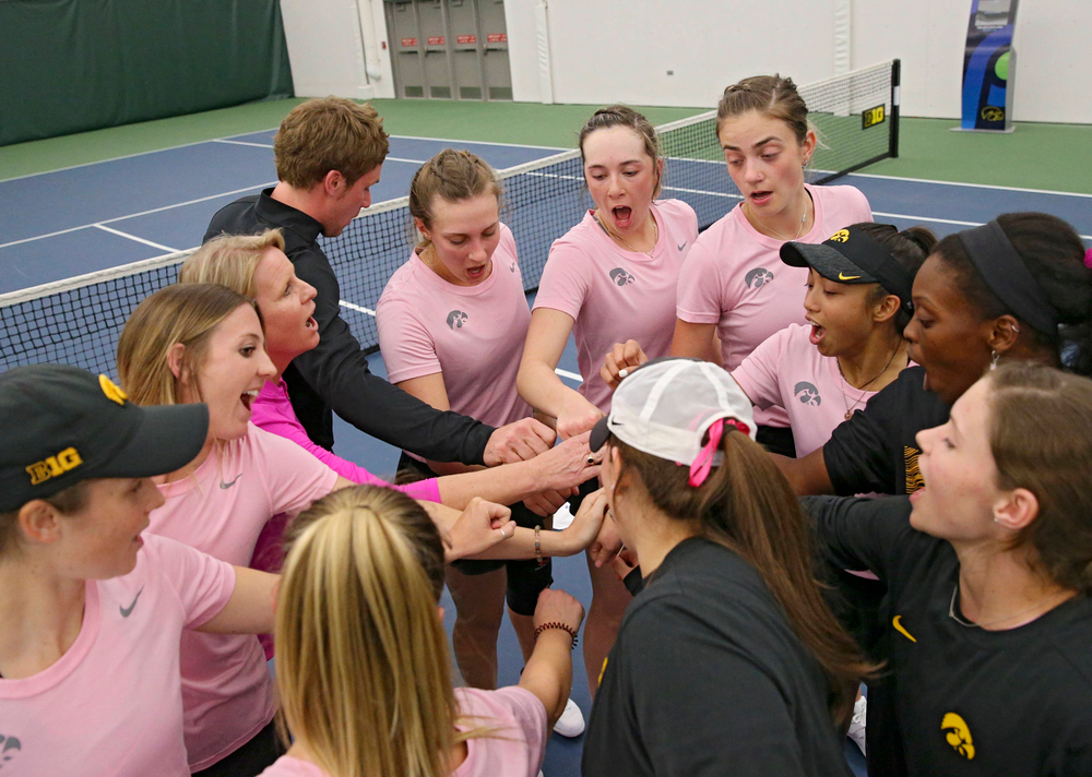 The Iowa Hawkeyes huddle after winning their match against Purdue at the Hawkeye Tennis and Recreation Complex in Iowa City on Friday, Mar. 29, 2019. (Stephen Mally/hawkeyesports.com)