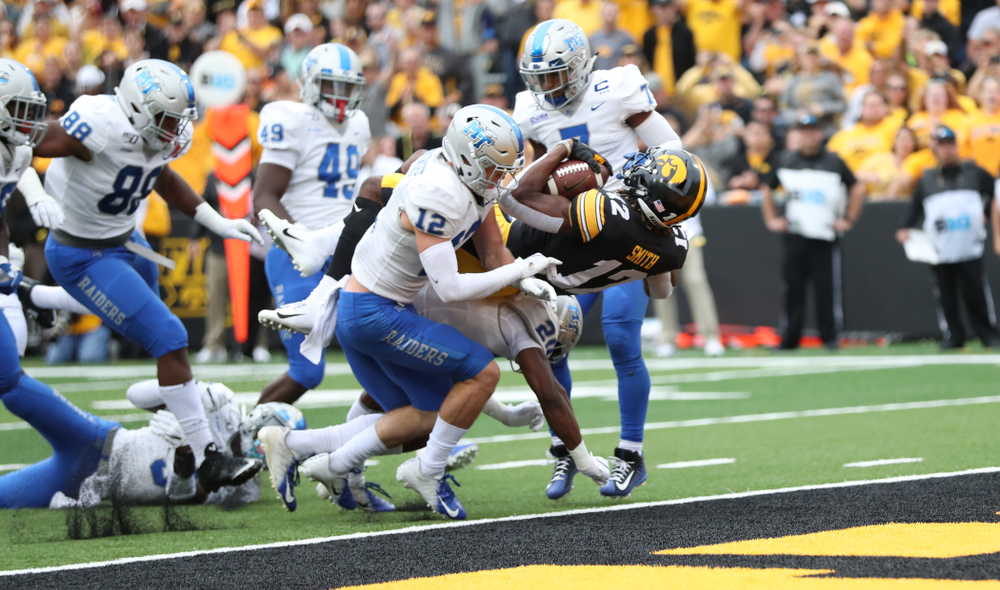 Iowa Hawkeyes wide receiver Brandon Smith (12) scores against Middle Tennessee State Saturday, September 28, 2019 at Kinnick Stadium. (Max Allen/hawkeyesports.com)