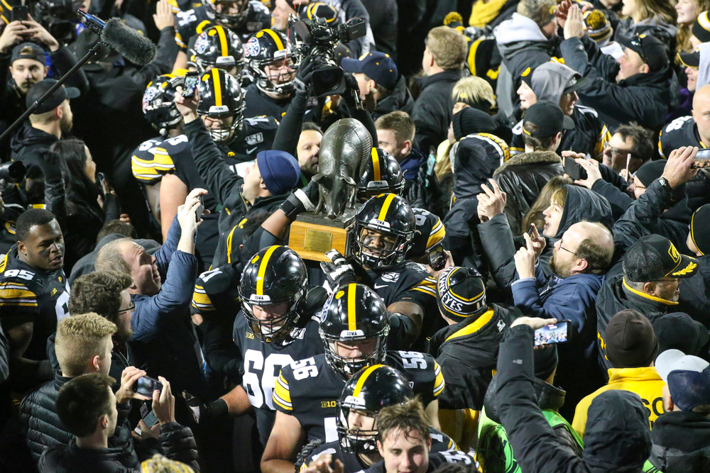 Iowa Hawkeyes carry the Floyd of Rosedale after Iowa football vs Minnesota on Saturday, November 16, 2019 at Kinnick Stadium. (Lily Smith/hawkeyesports.com)