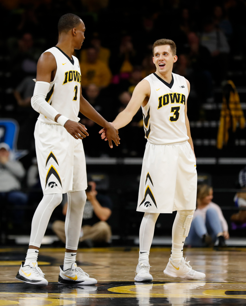 Iowa Hawkeyes guard Maishe Dailey (1) and guard Jordan Bohannon (3)