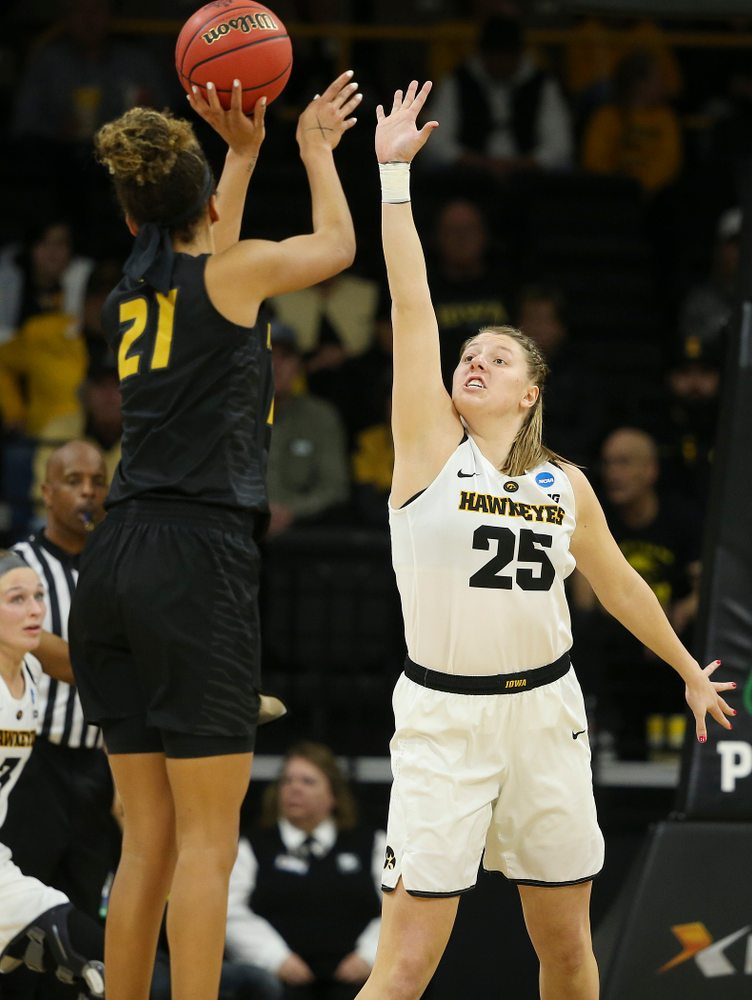 Iowa Hawkeyes center Monika Czinano (25) tries to get her hand on a shot during the second quarter of their second round game in the 2019 NCAA Women's Basketball Tournament at Carver Hawkeye Arena in Iowa City on Sunday, Mar. 24, 2019. (Stephen Mally for hawkeyesports.com)