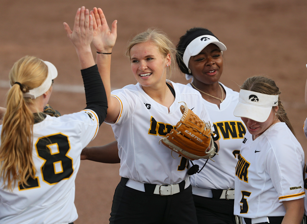 Iowa pitcher Sarah Lehman (16) gets a high-five from third baseman Ashley Hamilton (18) after ending the fifth inning of their game against Ohio State at Pearl Field in Iowa City on Friday, May. 3, 2019. (Stephen Mally/hawkeyesports.com)