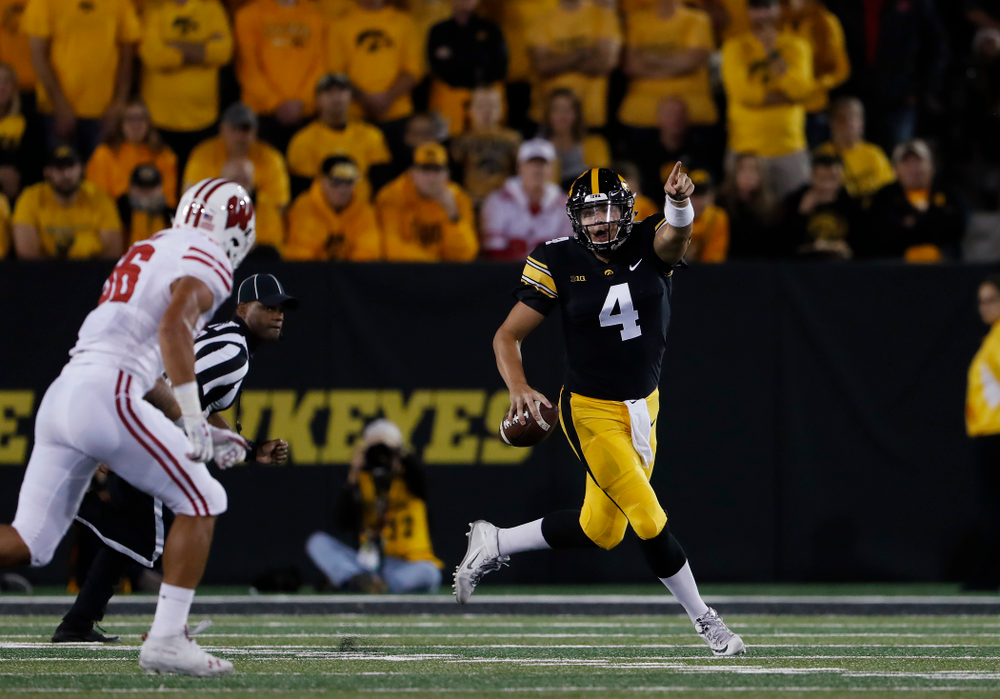 Iowa Hawkeyes quarterback Nate Stanley (4) points down the field against the Wisconsin Badgers Saturday, September 22, 2018 at Kinnick Stadium. (Brian Ray/hawkeyesports.com)
