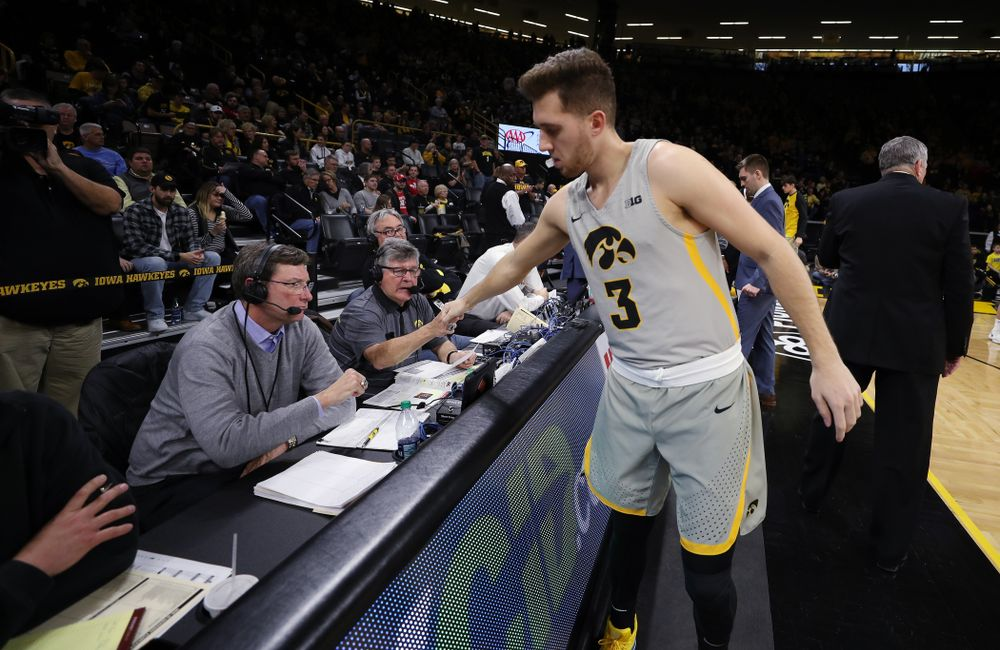 Iowa Hawkeyes guard Jordan Bohannon (3) fist bumps radio announcer Gary Dolphin before their game against the Nebraska Cornhuskers Sunday, January 6, 2019 at Carver-Hawkeye Arena. (Brian Ray/hawkeyesports.com)