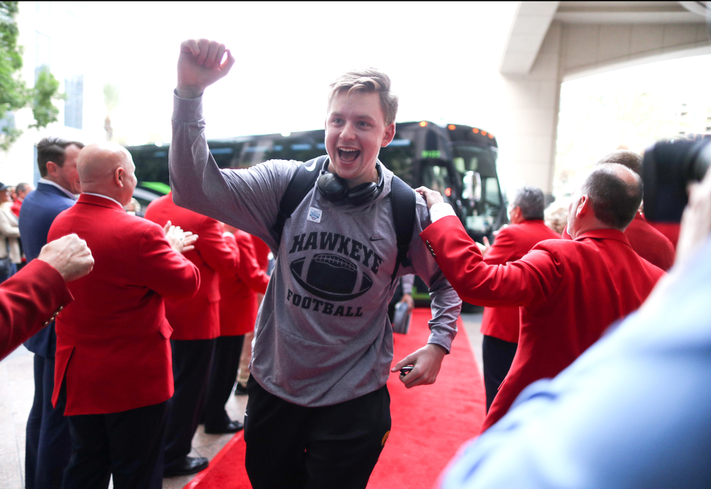 Iowa Hawkeyes quarterback Spencer Petras (7) shakes hands with the ÒRed CoatsÓ after arriving in San Diego, CA Saturday, December 21, 2019 for the Holiday Bowl. (Brian Ray/hawkeyesports.com)
