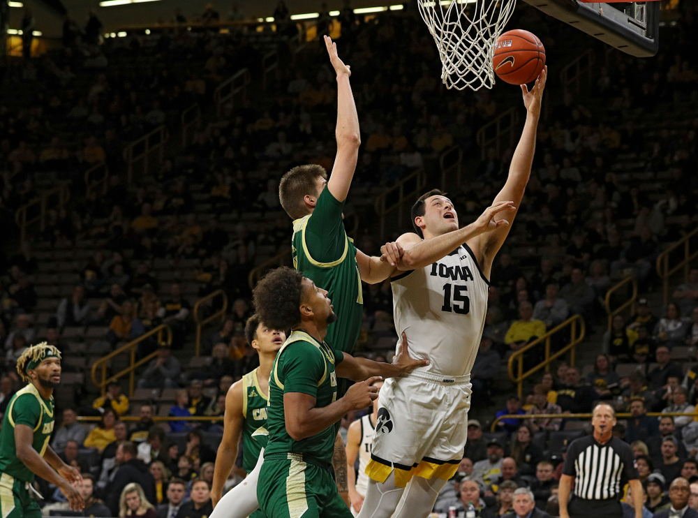 Iowa Hawkeyes forward Ryan Kriener (15) makes a basket during the second half of their game at Carver-Hawkeye Arena in Iowa City on Sunday, Nov 24, 2019. (Stephen Mally/hawkeyesports.com)