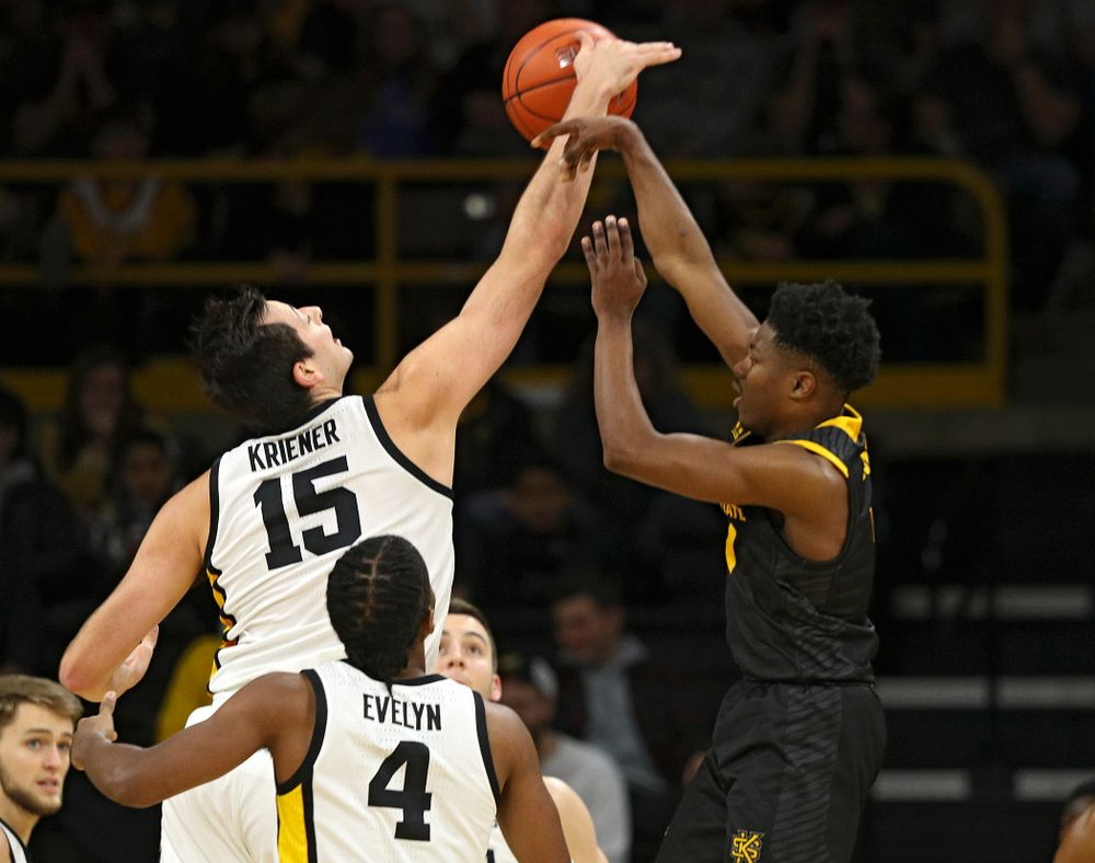 Iowa Hawkeyes forward Ryan Kriener (15) blocks a shot during the second half of their their game at Carver-Hawkeye Arena in Iowa City on Sunday, December 29, 2019. (Stephen Mally/hawkeyesports.com)