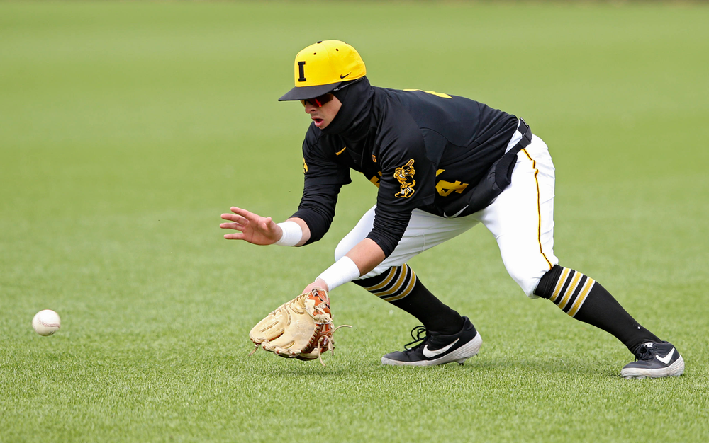 Iowa Hawkeyes second baseman Mitchell Boe (4) fields a ground ball during the first inning of their game against Illinois at Duane Banks Field in Iowa City on Saturday, Mar. 30, 2019. (Stephen Mally/hawkeyesports.com)