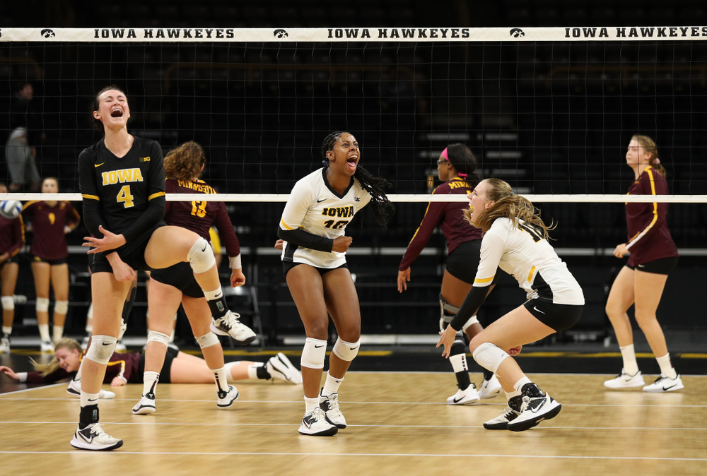 Iowa Hawkeyes outside hitter Griere Hughes (10) and defensive specialist Halle Johnston (4) against the Minnesota Golden Gophers Wednesday, October 2, 2019 at Carver-Hawkeye Arena. (Brian Ray/hawkeyesports.com)