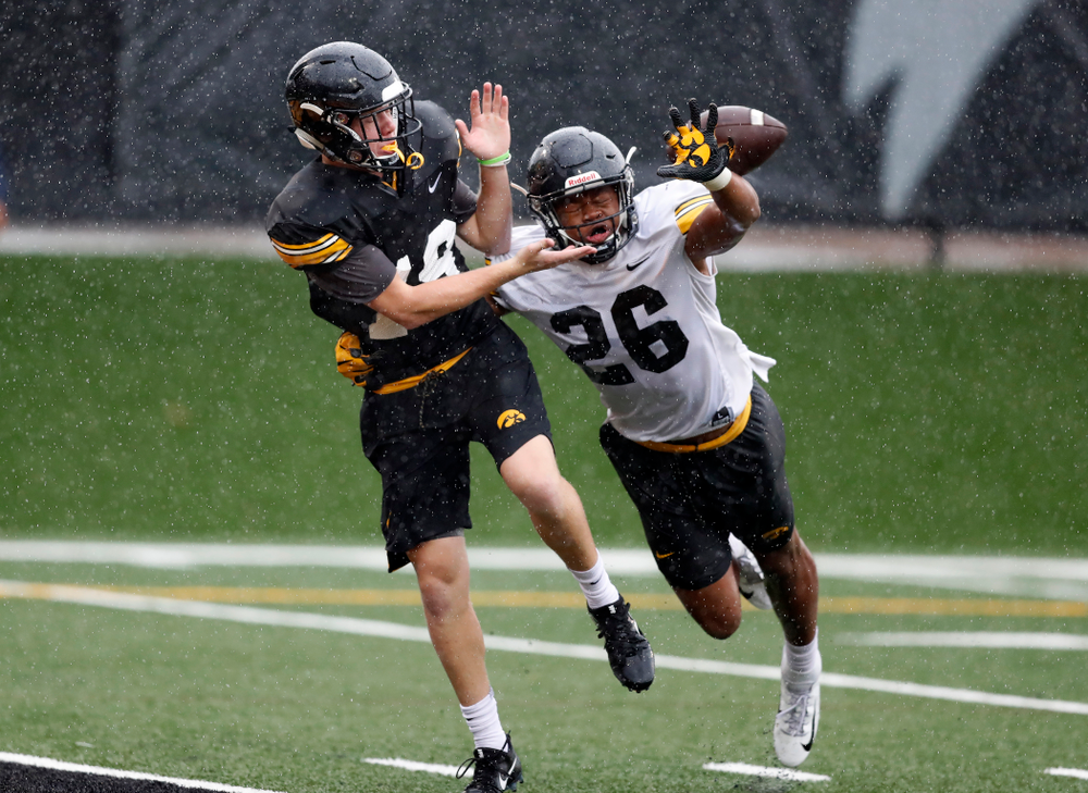 Iowa Hawkeyes wide receiver Max Cooper (19) and defensive back Kaevon Merriweather (26) during camp practice No. 15  Monday, August 20, 2018 at the Hansen Football Performance Center. (Brian Ray/hawkeyesports.com)