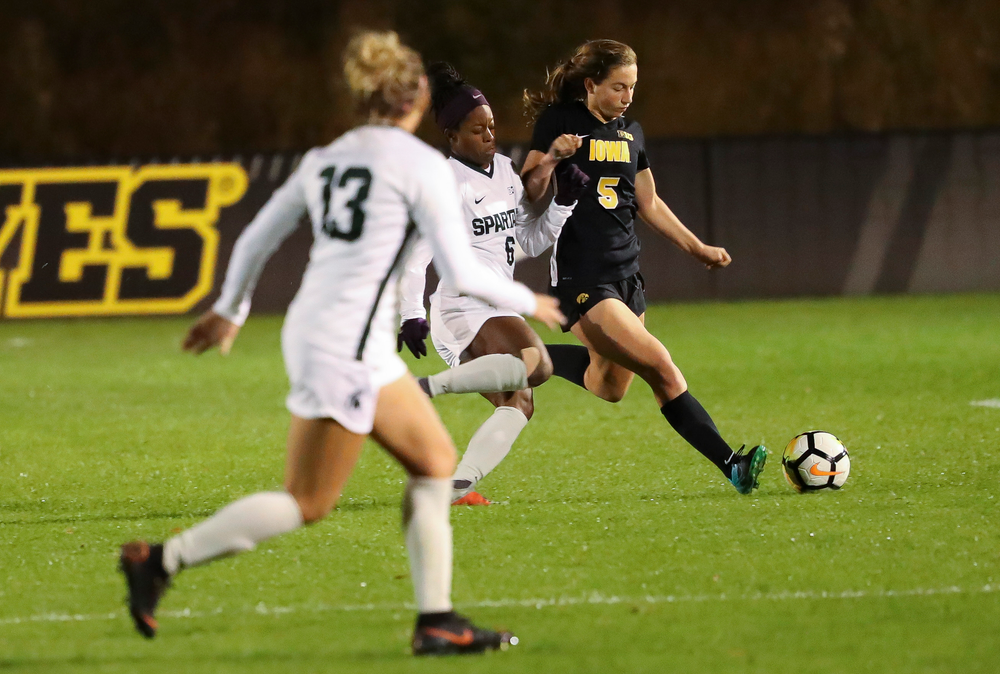 Iowa Hawkeyes defender Riley Whitaker (5) dribbles the ball during a game against Michigan State at the Iowa Soccer Complex on October 12, 2018. (Tork Mason/hawkeyesports.com)