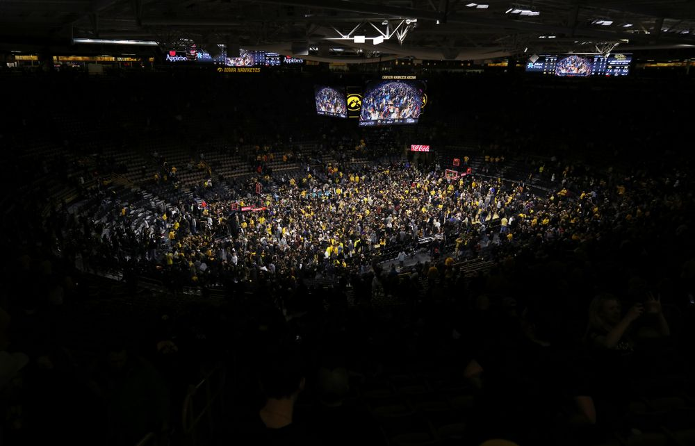 Fans storm the court after Iowa Hawkeyes defeated the Michigan Wolverines  Friday, February 1, 2019 at Carver-Hawkeye Arena. (Brian Ray/hawkeyesports.com)