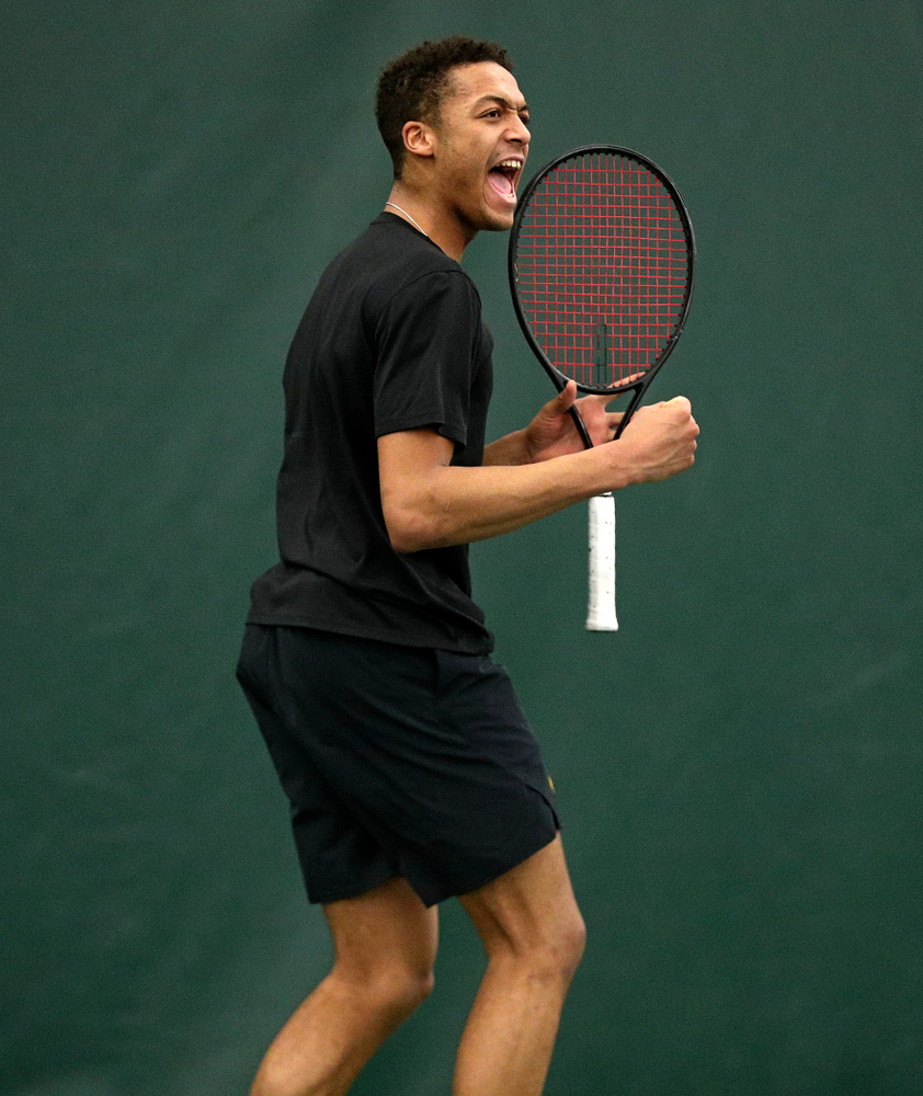 Iowa's Oliver Okonkwo celebrates a point during his singles match at the Hawkeye Tennis and Recreation Complex in Iowa City on Friday, March 6, 2020. (Stephen Mally/hawkeyesports.com)