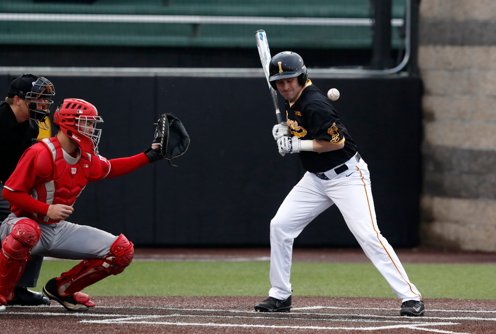 Iowa Hawkeyes infielder Chris Whelan (28) is hit by a pitch against the Bradley Braves Wednesday, March 28, 2018 at Duane Banks Field. (Brian Ray/hawkeyesports.com)
