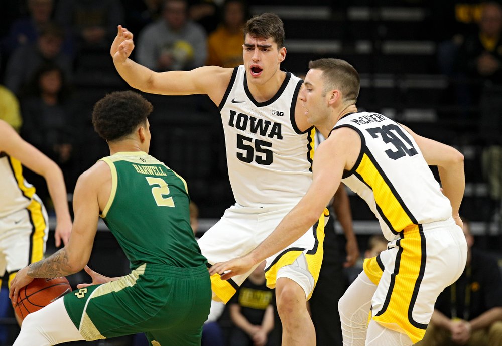 Iowa Hawkeyes center Luka Garza (55) and guard Connor McCaffery (30) pressure Cal Poly Mustangs forward Malek Harwell (2) during the first half of their game at Carver-Hawkeye Arena in Iowa City on Sunday, Nov 24, 2019. (Stephen Mally/hawkeyesports.com)
