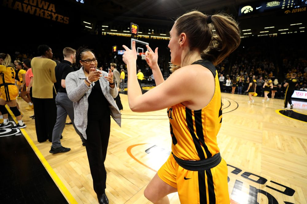 Iowa Hawkeyes forward Amanda Ollinger (43) and assistant coach Raina Harmon against the Minnesota Golden Gophers Thursday, February 27, 2020 at Carver-Hawkeye Arena. (Brian Ray/hawkeyesports.com)