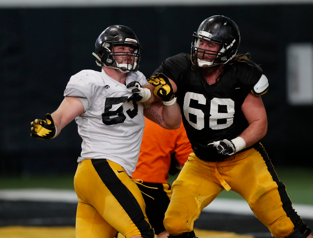 Iowa Hawkeyes defensive lineman Garret Jansen (53) and offensive lineman Landan Paulsen (68) during spring practice Wednesday, March 28, 2018 at the Hansen Football Performance Center.  (Brian Ray/hawkeyesports.com)