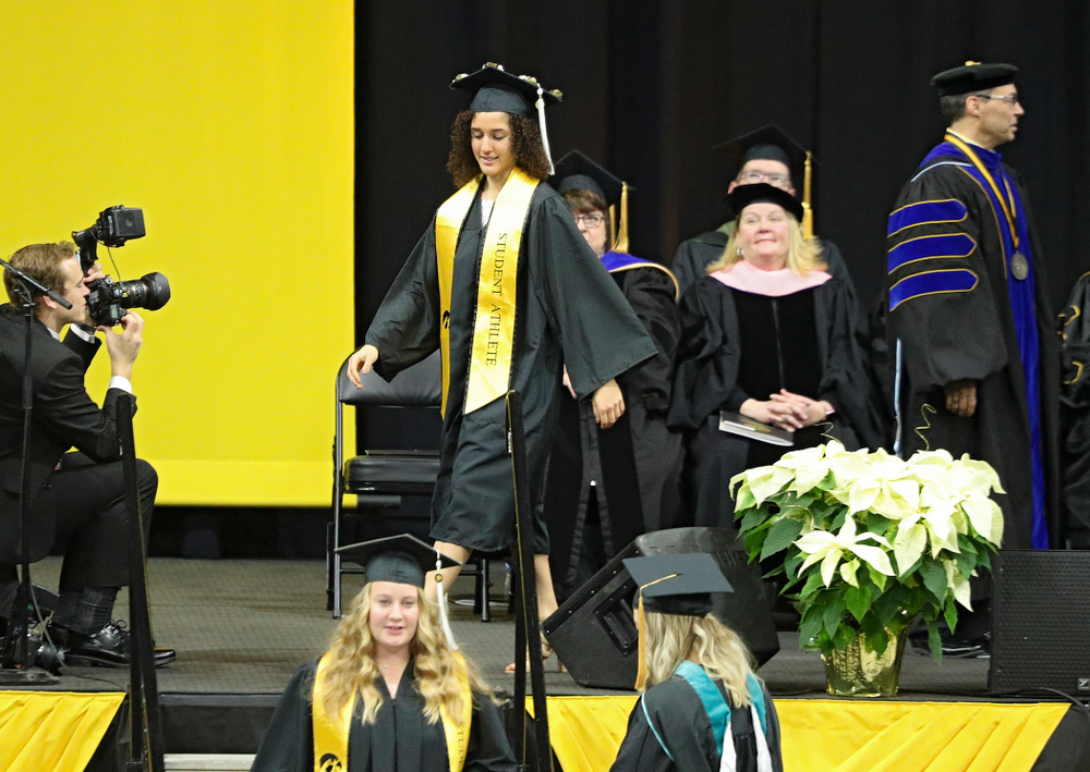 Iowa Track and Field's Tia Saunders during the College of Liberal Arts and Sciences and University College Fall 2019 Commencement ceremony at Carver-Hawkeye Arena in Iowa City on Saturday, December 21, 2019. (Stephen Mally/hawkeyesports.com)