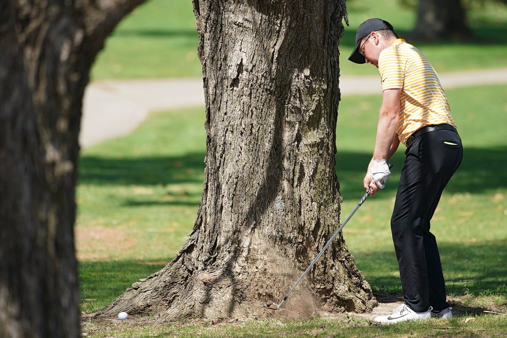 Iowa's Matthew Walker hits through the trees on the 18th hole during the third round of the Hawkeye Invitational at Finkbine Golf Course in Iowa City on Sunday, Apr. 21, 2019. (Stephen Mally/hawkeyesports.com)