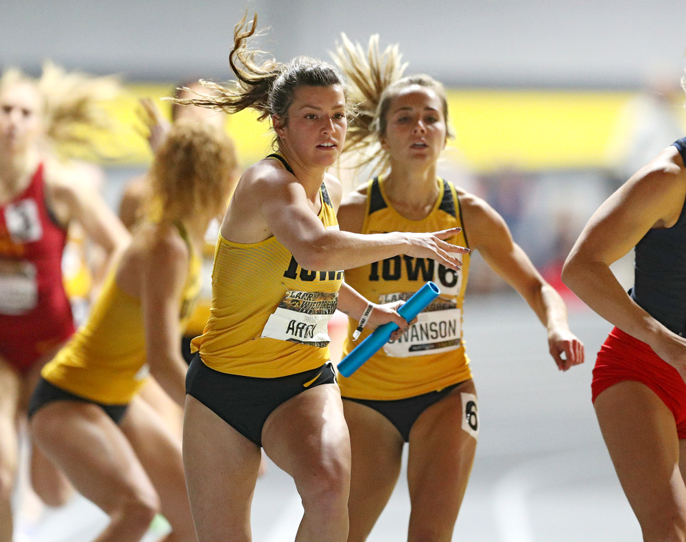 Iowa's Taylor Arco (from left) takes the baton from Addie Swanson as they run the women's 1600 meter relay event during the Larry Wieczorek Invitational at the Recreation Building in Iowa City on Saturday, January 18, 2020. (Stephen Mally/hawkeyesports.com)