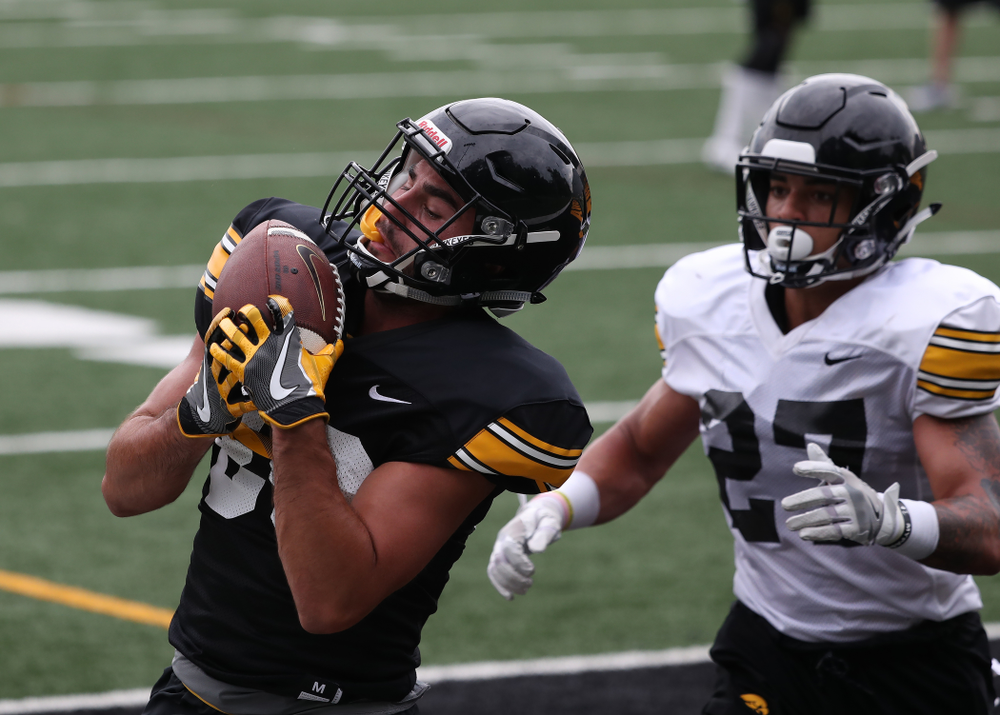 Iowa Hawkeyes wide receiver Nico Ragaini (89) and defensive back Amani Hooker (27) during practice No. 4 of Fall Camp Monday, August 6, 2018 at the Hansen Football Performance Center. (Brian Ray/hawkeyesports.com)