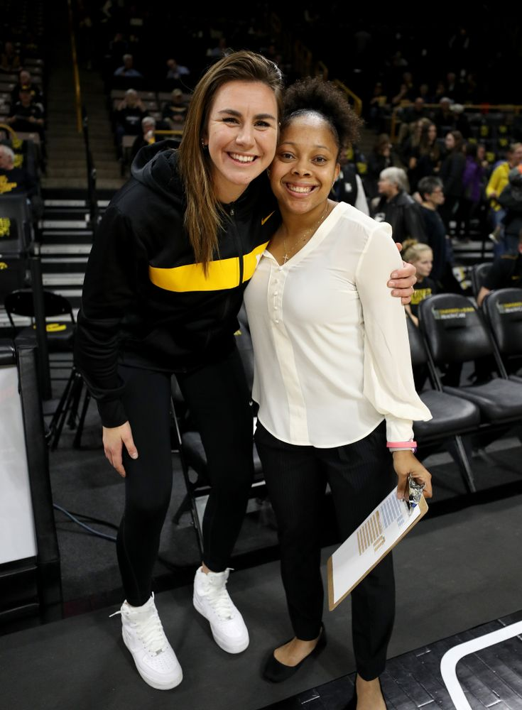 Former Hawkeyes Hannah Stewart and Tania Davis pose for a photo before the Iowa Hawkeyes game against Clemson Wednesday, December 4, 2019 at Carver-Hawkeye Arena. (Brian Ray/hawkeyesports.com)