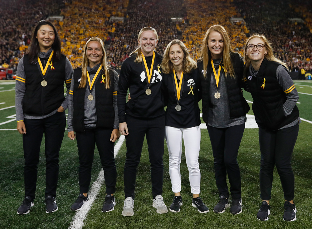 Members of the Iowa women's golf team are recognized by the Presidential Committee on Athletics at halftime during a game against Wisconsin on September 22, 2018. (Tork Mason/hawkeyesports.com)