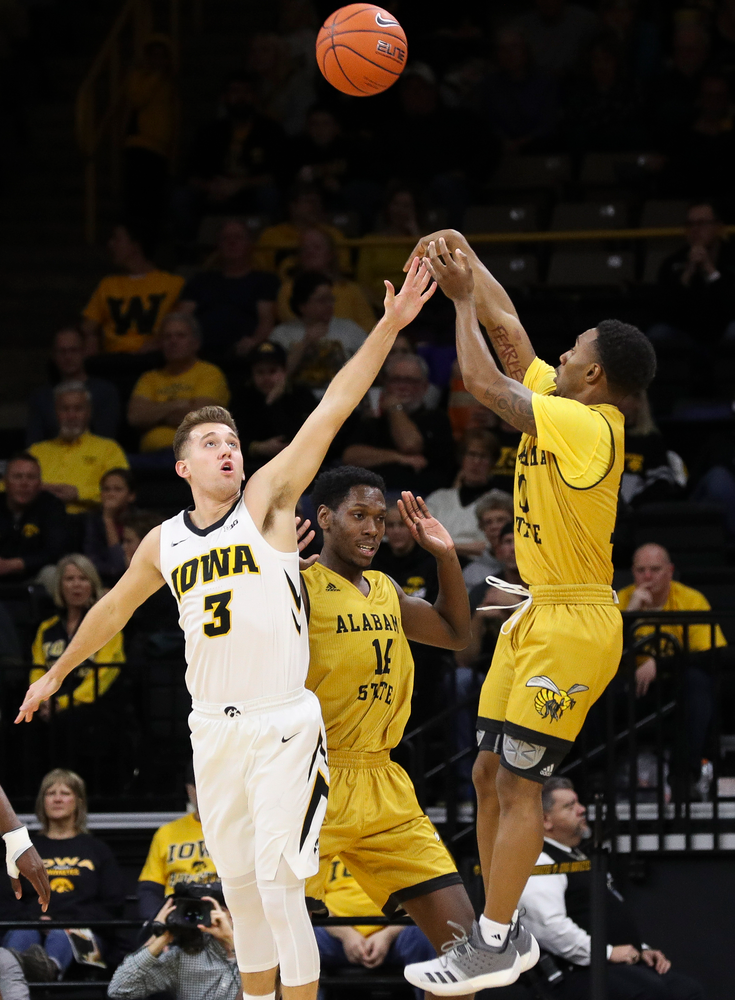 Iowa Hawkeyes guard Jordan Bohannon (3) contests a shot during a game against Alabama State at Carver-Hawkeye Arena on November 21, 2018. (Tork Mason/hawkeyesports.com)