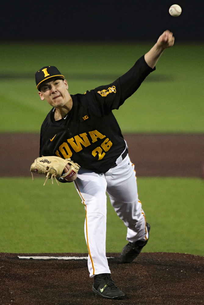 Iowa pitcher Adam Ketelsen (26) delivers to the plate during the seventh inning of their game at Duane Banks Field in Iowa City on Tuesday, March 3, 2020. (Stephen Mally/hawkeyesports.com)