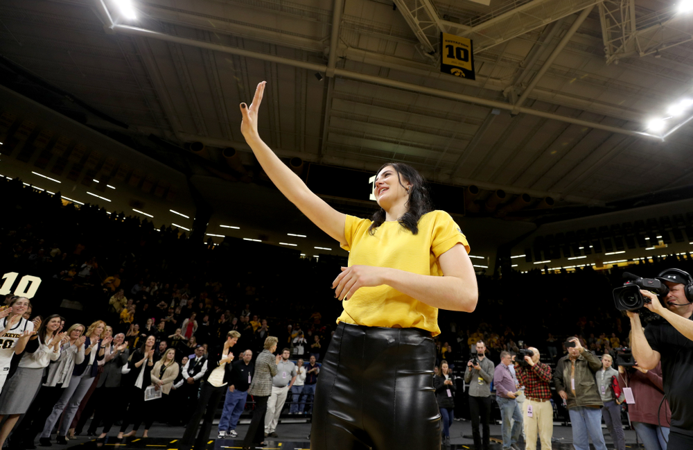 Megan Gustafson waves to the fans after her number was raised into the rafters during a jersey retirement ceremony Sunday, January 26, 2020 at Carver-Hawkeye Arena. (Brian Ray/hawkeyesports.com)