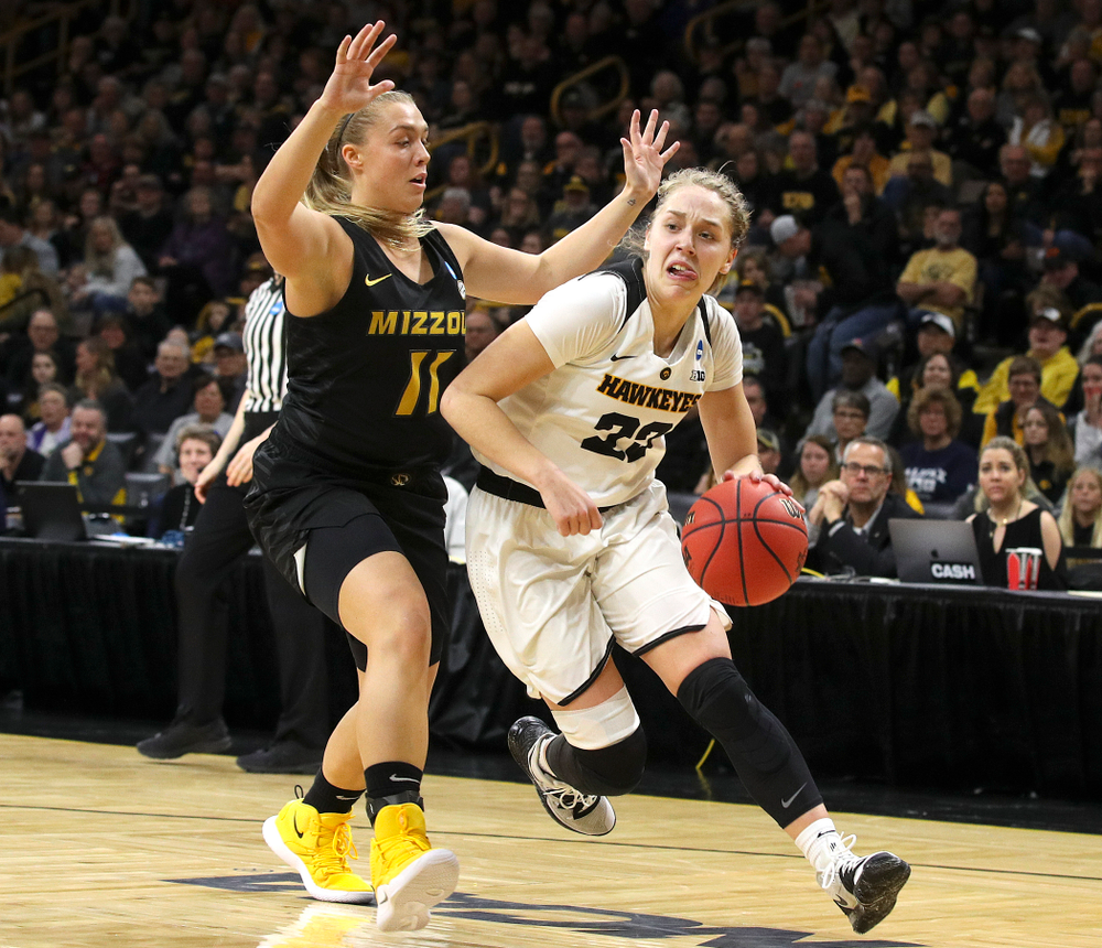 Iowa Hawkeyes guard Kathleen Doyle (22) drives with the ball during the second quarter of their second round game in the 2019 NCAA Women's Basketball Tournament at Carver Hawkeye Arena in Iowa City on Sunday, Mar. 24, 2019. (Stephen Mally for hawkeyesports.com)
