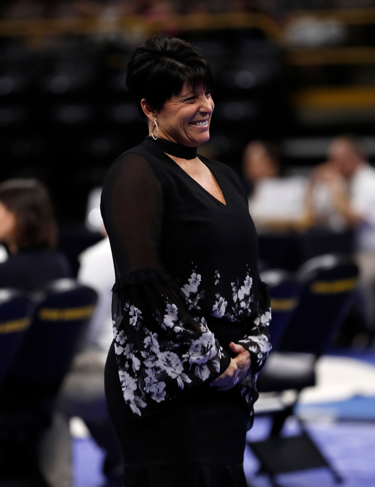 Iowa assistant coach Jennifer Green competes on the beam against the Nebraska Cornhuskers