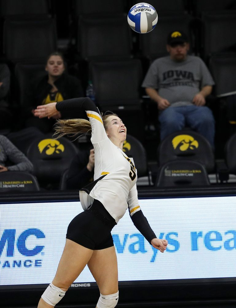 Iowa Hawkeyes outside hitter Meghan Buzzerio (5) spikes the ball during a match against Maryland at Carver-Hawkeye Arena on November 23, 2018. (Tork Mason/hawkeyesports.com)