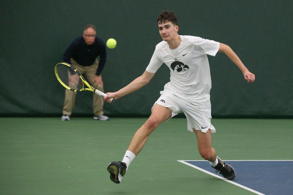 Iowa's Matt Clegg returns a hit during the Iowa men's tennis meet vs Nebraska on Sunday, March 1, 2020 at the Hawkeye Tennis and Recreation Complex. (Lily Smith/hawkeyesports.com)