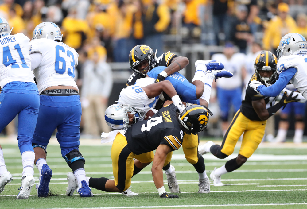 Iowa Hawkeyes linebacker Barrington Wade (35) and defensive back Dane Belton (4) against Middle Tennessee State Saturday, September 28, 2019 at Kinnick Stadium. (Max Allen/hawkeyesports.com)