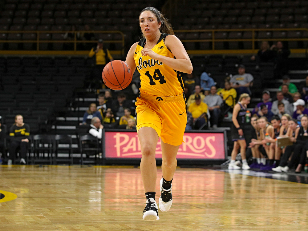 Iowa guard/forward McKenna Warnock (14) brings the ball down the court during the third quarter of their game against Winona State at Carver-Hawkeye Arena in Iowa City on Sunday, Nov 3, 2019. (Stephen Mally/hawkeyesports.com)