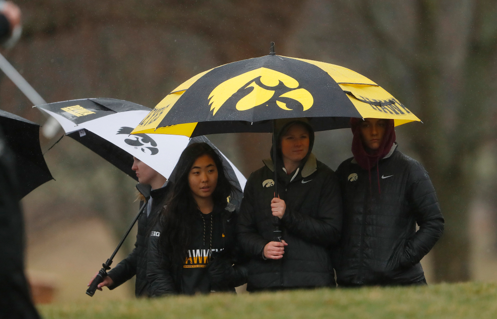 The Iowa Women's golf team watches as the men compete during day two of the 2018 Hawkeye Invitational Friday, April 13, 2018 at Finkbine Golf Course. (Brian Ray/hawkeyesports.com)