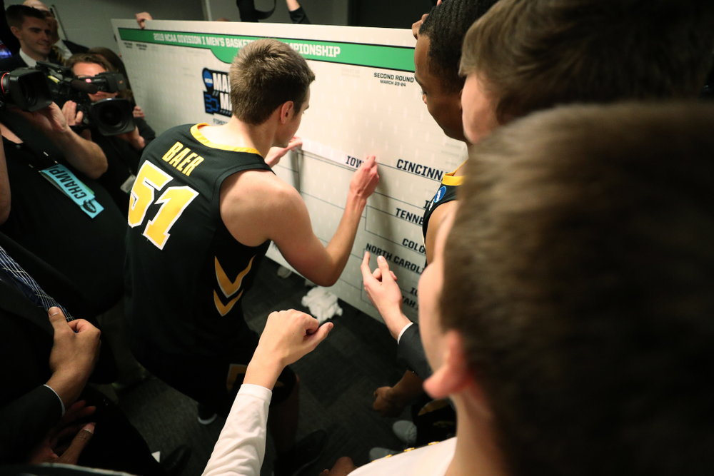 Iowa Hawkeyes forward Nicholas Baer (51) advances the team on the bracket following their game against the Cincinnati Bearcats in the first round of the 2019 NCAA Men's Basketball Tournament Friday, March 22, 2019 at Nationwide Arena in Columbus, Ohio. (Brian Ray/hawkeyesports.com)